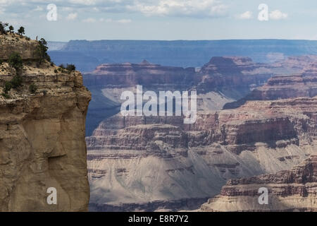 Person (on the left upper corner) viewing the Grand Canyon. Grand Canyon National Park, Arizona, USA - Stock Photo