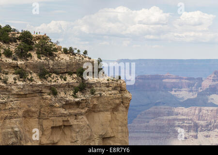 People (on the left upper corner) viewing the Grand Canyon. Grand Canyon National Park, Arizona, USA - Stock Photo