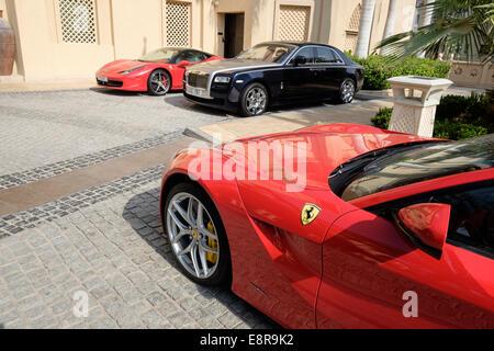 Luxury cars parked outside 5-star hotel in Dubai United Arab Emirates - Stock Photo