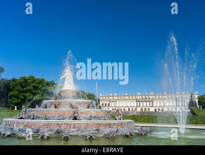 Herrenchiemsee Palace on an island in lake Chiemsee, water games with the Latona fountain and western facade, Bavaria, - Stock Photo