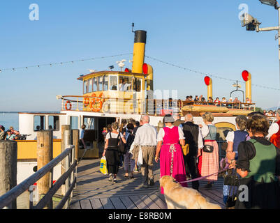 Lake Chiemsee, tourists boarding the excursion boat after visiting the Herrenchiemsee Palace, Bavaria, Germany. - Stock Photo