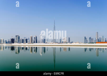 View across The Creek towards skyline of Dubai and Burj Khalifa at Business Bay in United Arab Emirates - Stock Photo