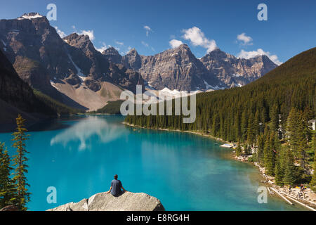 A man enjoying the view of Moraine Lake, Banff National Park, Alberta, Canada, America. - Stock Photo