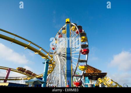 The roller coaster & ferris wheel in Pacific Park Amusement Park on Santa Monica Pier, Los Angeles, California, - Stock Photo