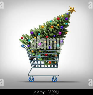 Christmas shopping concept as a store shop cart hauling a decorated festive holiday pine tree as a symbol for black - Stock Photo