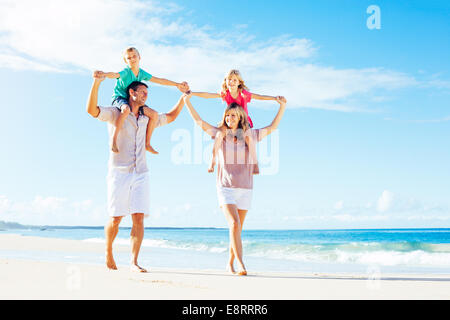 Photo of Happy Family Having Fun on the Beach. Summer Lifestyle. - Stock Photo