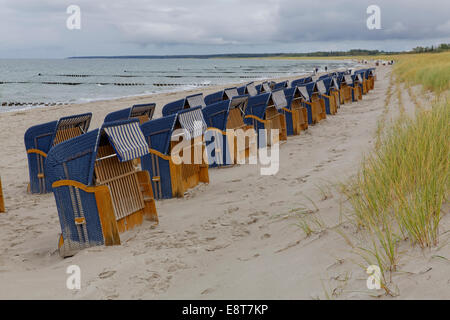 Wicker beach chairs on the beach of Ahrenshoop, Mecklenburg-Vorpommern, Germany - Stock Photo