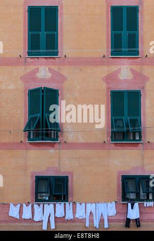 Laundry drying on an old house in Santa Margherita Ligure, Liguria, Italy - Stock Photo