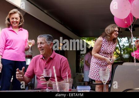 Caucasian family celebrating at party - Stock Photo