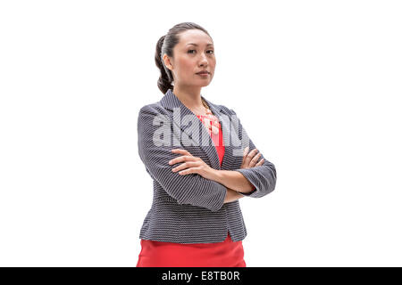 Pacific Islander businesswoman standing with arms crossed - Stock Photo