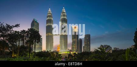 Illuminated skyscrapers in Kuala Lumpur city skyline, Kuala Lumpur, Malaysia - Stock Photo