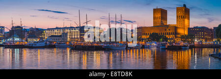 Panoramic view of Oslo harbor and city skyline at sunset, Ostlandet, Norway - Stock Photo