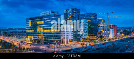 Buildings in Oslo city skyline at sunset, Ostlandet, Norway - Stock Photo