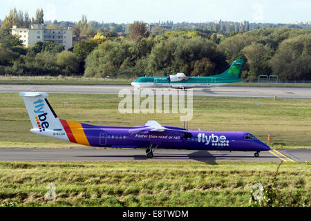 Flybe DHC Dash 8 and Aer Lingus ATR-72 aircraft at Birmingham Airport, UK - Stock Photo