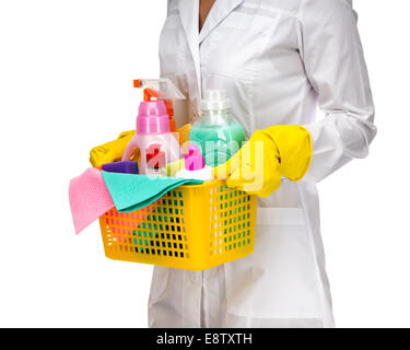 Cleaner maid woman with plastic basket and cleaning supplies on white background - Stock Photo