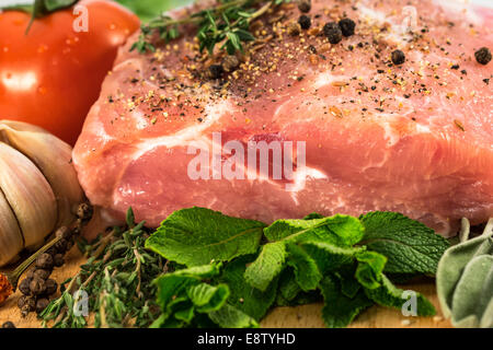 Food. Raw Meat for barbecue with fresh Vegetables and Mushrooms on wooden surface. Meat Raw Steak and spices for - Stock Photo