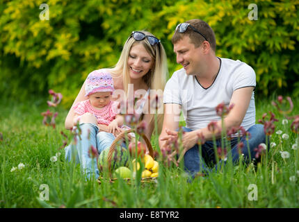 Portrait Of Happy Family In Garden - Stock Photo