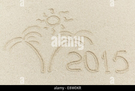 new year 2015 message on the sand beach - Stock Photo