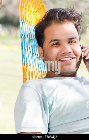 1 Indian man Talkig with moblie - Stock Photo