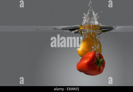 Spicy Red cocktail splash in a Martini glass - Stock Photo
