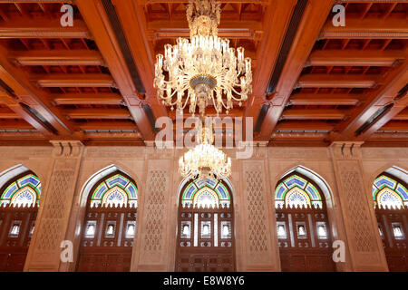 Prayer room for women with a wooden ceiling and a chandelier, Sultan Qaboos Grand Mosque, Muscat, Oman - Stock Photo