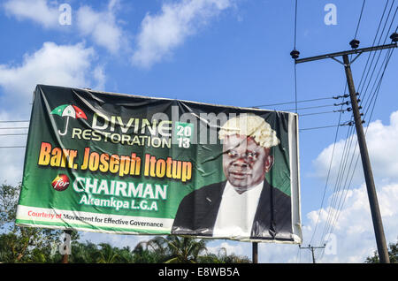 Divine restoration road sign with Barr. Joseph Itotup for the Akampa LGA local elections in the Cross River state - Stock Photo