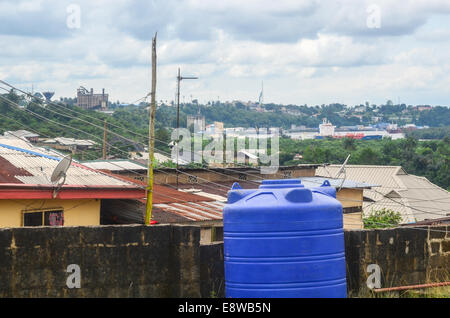 View of the city of Calabar, Nigeria, and boat in the Cross River - Stock Photo