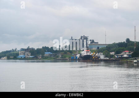 Cross River, where the oil pipelines run, and factory/plant, in Calabar, Nigeria - Stock Photo