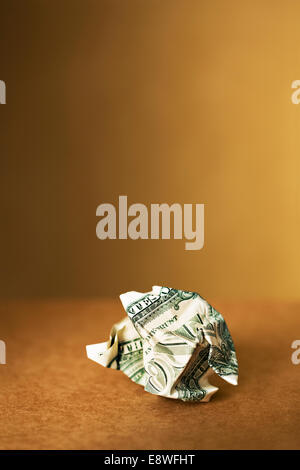 Close up of crumpled dollar bill on counter - Stock Photo