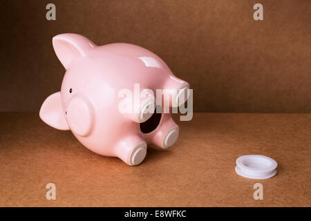 Empty piggy bank with stopper on counter - Stock Photo