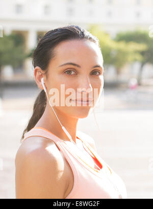 Woman listening to music before exercising - Stock Photo