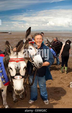 UK, England, Lancashire, Morecambe, sandcastle festival, Paddy and Ginger donkeys on the beach, with Karen Richardson - Stock Photo