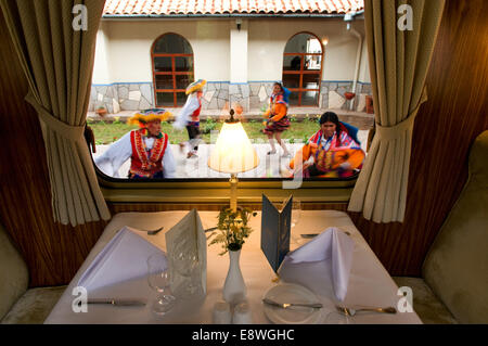 Peru Luxury train from Cuzco to Machu Picchu. Orient Express. Belmond. Train inside. Musicians and dancers in traditional - Stock Photo