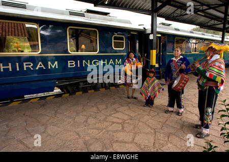 Peru Luxury train from Cuzco to Machu Picchu. Orient Express. Belmond. Musicians and dancers in traditional costumes - Stock Photo