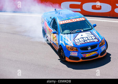A blue Hotwheels display team 'Ute' or Pick Up truck drifting round the iconic Bathurst racetrack - Stock Photo