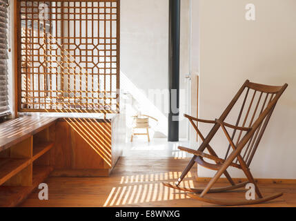 Blinds casting shadows in modern bedroom - Stock Photo