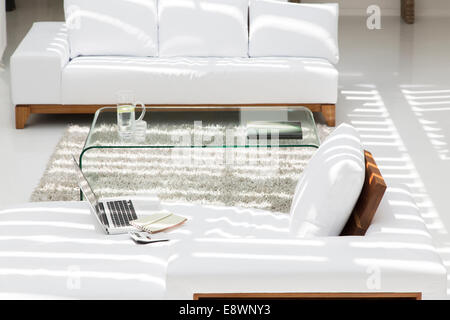Laptop, sofas and coffee table in modern living room - Stock Photo