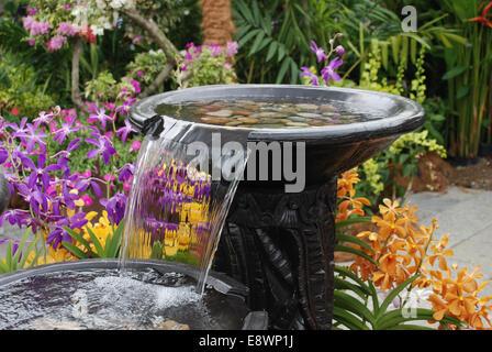 Water fountain in garden landscape - Stock Photo