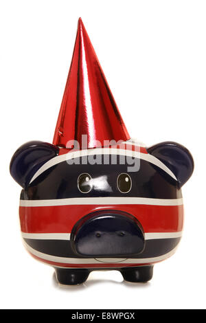 Piggy bank wearing red party hat cutout - Stock Photo