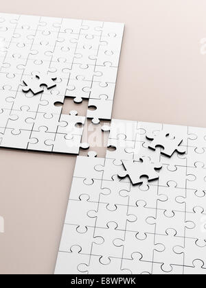 Close up of connecting puzzle with scattered pieces - Stock Photo