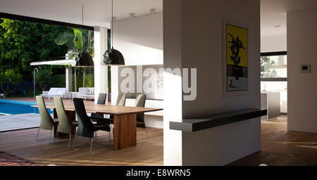 Wooden dining table in open plan space of D House, Israel, Middle East. - Stock Photo