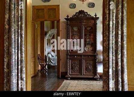 View through curtains to cabinet in La Maison Creole a French colonial house, Eureka house, House of 109 doors in - Stock Photo