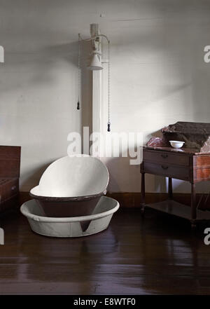 Antique bathtub in La Maison Creole a French colonial house, Eureka house, House of 109 doors in Moka, Mauritius.