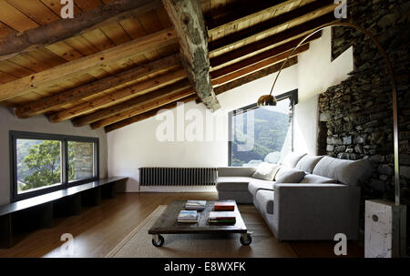Sitting room in old stone farm which has been converted in family home, Mas La Riba, Vilallonga de Ter, Girona, - Stock Photo
