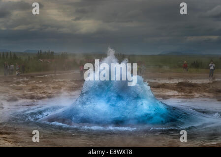 Strokkur about to erupt. Strokkur is a fountain geyser by the Hvita River in the Haukadalur valley, Iceland. - Stock Photo