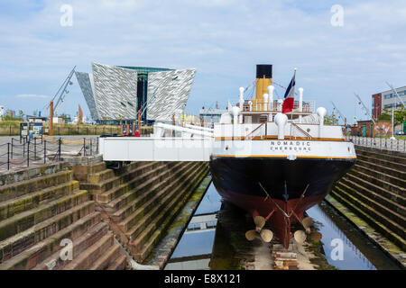 The steamship tender SS Nomadic with Titanic Belfast museum behind, Titanic Quarter, Belfast, Northern Ireland, - Stock Photo