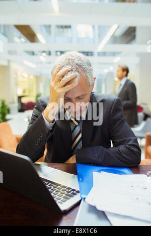 Businessman resting while working in office building - Stock Photo