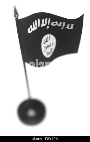 Small flag of ISIL, ISIS in a stand isolated on a white background. High angle with shallow depth of field. - Stock Photo
