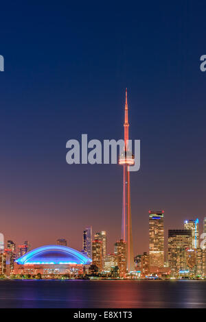 Famous Toronto Skyline with the CN Tower and Rogers Centre after sunset taken from the Toronto Islands. - Stock Photo