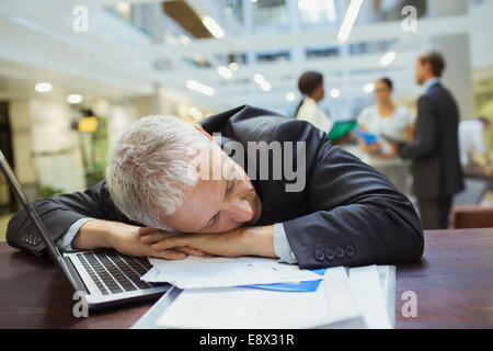 Businessman resting in office building - Stock Photo